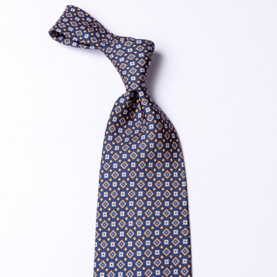 Blaue Krawatte aus reiner Seide  mit orangenen Details.