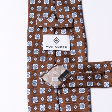 Brown tie made from pure silk  printed with an floral pattern
