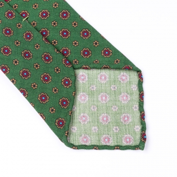 Dark green tie made from pure wool  printed with an floral pattern