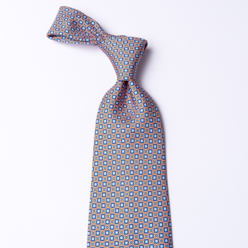 Tie from pure silk  with an orange/blue floral pattern