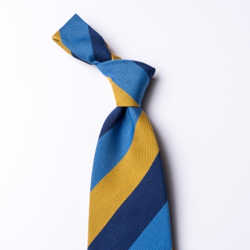 Striped tie in light blue - dark blue - yellow  made of cotton and silk